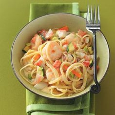 """Seafood Pasta Alfredo Recipe -""""My husband loves seafood, and I created this recipe one night with a little of this and a little of that. Luckily, I wrote it down because he asks for this dish often.""""—Rebekah Beyer, Sabetha, Kansas"""