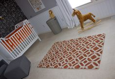 This orange rug is a great find from @Home Depot! #projectnursery #orangerug