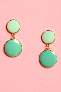 Check it out from Lulus.com! Get your look really going when you add the You Really Dot Me Now Mint Green Earrings into the mix! Two golden discs are lacquered pastel green, with a smaller, mint green circle above, and a larger, slightly darker shade of green below for a cute, dangly look. Earrings dangle 1.75
