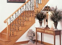 Stairway Featuring Scroll and Double-Twist Iron Balusters, Pin Top Newel Posts, Vertical Volute