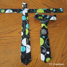Little Man Ties These ties have a double snap closure around the neck for safety and adjustability. The knot is sewn so they can't be undone, thereby eliminating the fuss of tying a tie.