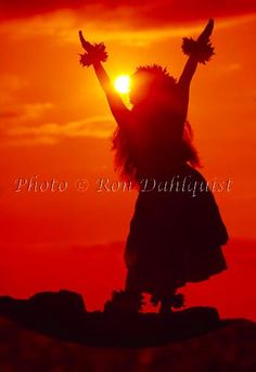 Silhouette of hula dancer at sunset. Maui, Hawaii Picture Photo