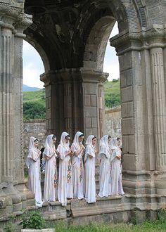 Armenian girls in traditional dress prepare for religious ceremony at the Tatev Monastery in Armenia