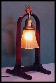 Early Gus. Originals of Gustav Stickley's Number 501 lamp (often called the Compass Lamp because of its resemblance to Stickley's bentwood compass logo) are rare and bring thousands of dollars at auction. I build these reproductions in mahogany, cherry and the more traditional quartered white oak in dark Mission brown . The lamps can be had with either of the shades shown on this page.