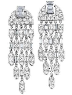 A Pair of Diamond Ear Pendants, CARTIER Each designed as a cascade of circular and baguette-cut diamond geometric links, to the circular and baguette-cut diamond plaque surmount, mounted in platinum, length 2 inches. Signed 'Cartier', no.754478, with assay marks