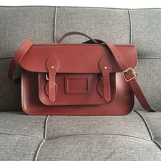 """15"""" Cambridge Batchel 15"""" satchel from the Cambridge Satchel Company. Color is burgundy but looks lighter in photos due to lighting. I've only worn it once and is basically new. It comes with a dust bag. Cambridge Satchel Bags Laptop Bags"""