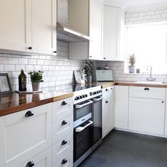 Who else loves the clean, fresh look of a white kitchen We are massive fans of Ruth s walnut worktop, the dark tones of the timber beautifully contrast with the light cabinets and tiles to create a stunning kitchen. Kitchen Worktop, Kitchen Tops, Kitchen Flooring, New Kitchen, Apartment Kitchen, Home Decor Kitchen, Small Galley Kitchens, All White Kitchen, Studio Kitchen