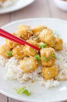 Crispy Honey Garlic Tofu! Better than takeout! Crispy baked tofu nuggets in a sweet garlic sauce. Perfect over brown rice or steamed vegetables! Vegetarian.   www.delishknowledge.com