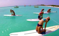 Paddle Board Yoga. I wish I could do this workout every single morning!!