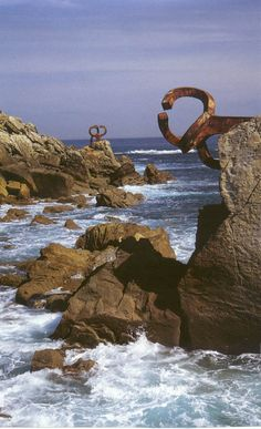 "Peine de los vientosDonostia (San Sebastian, Spain) Iron sculpture, welded into the rocks, by Basque artist Eduardo Chillida called ""Comb of the Winds""."