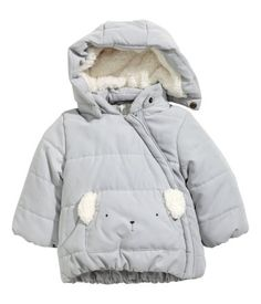 Light gray. Padded jacket in woven fabric with a soft, brushed finish. Detachable, pile-lined hood, diagonal zip at front, and a kangaroo pocket with