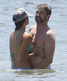 Main squeeze: Morgan pulled her man in close during their cooling dip in the Malibu waters...
