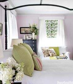 Love the wall color, wallpapered window shades and other accents and décor in the bedroom. Fresh and airy