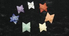 """1/2"""" carved Merkabas. Set of seven, include Clear Quartz, amethyst, lapis lazuli, green aventurine, yellow aventurine, orange aventurine, and red jasper. Merkabas are tetrahedrons, made by the intersection of two, three-sided pyramids. Merkabas are great tools for working on your spiritual transformation, which some believe is the whole purpose of our existence. Merkabas are believed to form a spiritual shield around the holder. In upper dimensions, the geometric shape of the human energy…"""