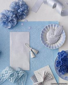 Blue has a long association with weddings, symbolizing purity and fidelity. Paired with silver, the normally serene blue takes on an inviting, festive air that befits a celebration -- especially one in the winter. And the palette can be tailored to a snaz