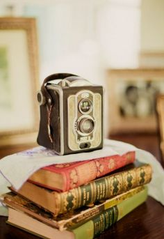 I have my grandfather's old Kodak camera. It looks just like this one and I love it.