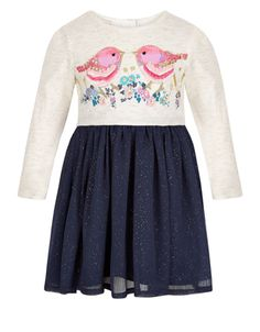 Tweet, tweet! Our Elsie May day dress for baby girls is crafted with a jersey bodice with embellished birds, and a softly-gathered woven skirt with glittery spots. Features back button fastenings.