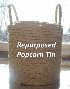 rope-covered popcorn tin ~ nice basket or planter (might need to add drainage holes)