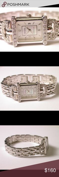 """Ladies Ecclissi and Diamond Watch Vintage designer Ecclissi Heavy Sterling Silver Watch with Diamond accents. Weighs 1.825 Troy OZ. Moisture resistant. Body, case and band Solid Sterling Silver. 14 Diamonds totaling .10 TCW. All links removable. Band 1/2"""" Wide with fold over style clasp. Mother of Pearl type sheen on face of dial. No box Ecclissi Accessories Watches"""