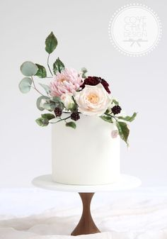 small wedding cakes Floral Wedding Cakes Pretty single tier wedding cake with sugar flower bouquet including sugar chrysanthemum, pompom dahlia, OHara rose, blackberries and assorted leaves. Small Wedding Cakes, Luxury Wedding Cake, Floral Wedding Cakes, Wedding Cakes With Cupcakes, Flower Cupcakes, Wedding Cakes With Flowers, Floral Cake, Beautiful Wedding Cakes, Wedding Cake Designs
