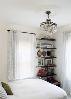 chandalier, open shelves & white curtains.