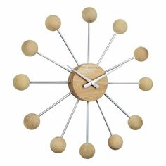London Clock Company The solid wood 'Sputnik' wall clock will add warmth and style to your room. The mix of wood and metal gives this sputnik clock a modern feel whilst keeping its simple Scandinavian inspired roots. Wall Clock London, Wood And Metal, Solid Wood, Wall Art Uk, Minimalist Wall Clocks, Black Clocks, Modern Canvas Art, Portrait Wall, Wall Clock Online