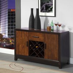 A two-tone acacia and espresso finish lends modern elegance to this multi storage server. Featuring a sturdy construction that features ample storage units with a mid single drawer, and wine rack feature. Perfect piece to complete any dining décor!