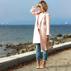 Pastel pink overcoat and boyfriend jeans.