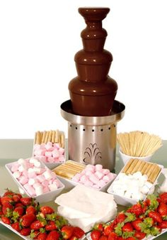 Chocolate fountains are extremely popular at weddings nowadays, but in my experience, you need to be careful. Having one can be great and who doesn't love chocolate? But if you set it up in the same r (Fountain Chocolate Ideas) Chocolate Fountain Rental, Chocolate Fountain Recipes, Chocolate Fountains, Chocolate Fountain Wedding, Chocolate Fondue Bar, Hotel Chocolate, Candy Table, Candy Buffet, Fuente De Chocolate Ideas