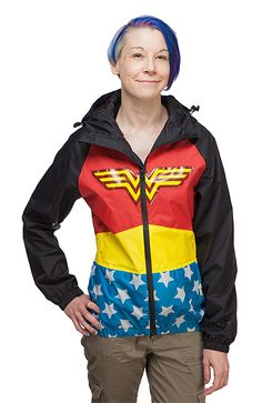 """Let the Wonder Woman Rain Jacket protect you from the elements with all the power of an Amazon princess. Pair it with some knee-high red galoshes to complete that rainy day """"I just stepped out of my invisible jet"""" look!"""