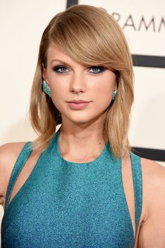 Taylor Swift's Colorful Eyeliner + Soft Pink Lip: http://www.stylemepretty.com/2015/11/04/celebrity-hair-makeup-looks-to-steal-for-your-wedding/