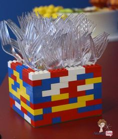 What a cute utensil holder for a Lego party!