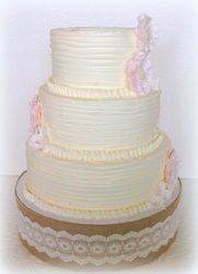 Country chic buttercream 3 tier with vintage soft blush ruffle flowers