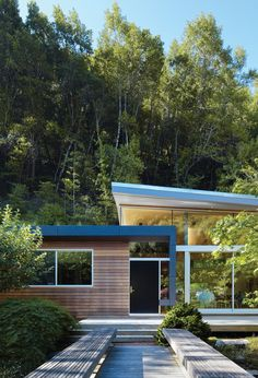 // looks like a small mid-century library - wouldn't that be fun to convert into a house ?!?