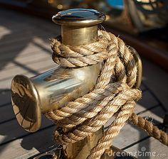 Nautical rope on the cleat by Volmart, via Dreamstime