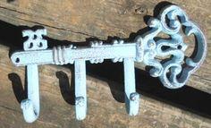 SALE - Tiffany Blue Cast Iron Rust and Shabby Chic Key holder wall hook. $9.95, via Etsy.