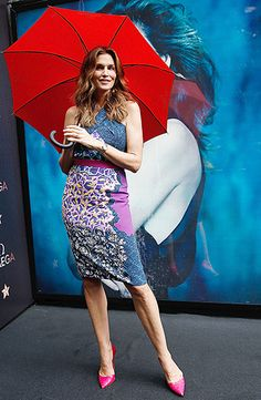 Cindy Crawford looked lovely in a colorful patterned knee-length dress and pink heels at the launch of the Omega Constellation Plum Collection.