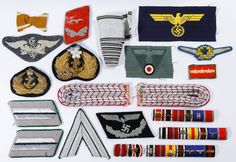 """Lot 352: World War II German Insignia and Regalia Assortment; Including insignia bar pins, bullion patches and an embroidered """"SS"""" ribbon for Nazi uniforms"""