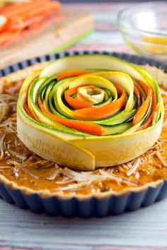Spiral Vegetable Tart: thinly sliced vegetables are the visual star of this edible artwork. With a layer of homemade sundried tomato pesto and a flaky pie crust, this tart is as delicious as it is beautiful! Vegan and gluten free options, too! Spiral Vegetable Recipes, Vegetable Tart, Tart Recipes, Baking Recipes, Vegan Recipes, Thanksgiving Vegetable Sides, Buzzfeed Tasty, Savoury Baking, Tomato Pesto