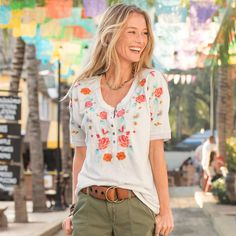 "ANASAZI BLOOMS HENLEY -- A Sundance favorite, updated with short sleeves and soft cotton slub. Short-sleeved henley shirt with breathtaking embroidery and a peek of lace at the sleeves. Easy fit. Machine wash. Imported. Exclusive. Sizes XS (2), S (4 to 6), M (8 to 10), L (12 to 14), XL (16). Front approx. 26""L."