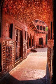 Red sandstone archway in a mosque at the Taj Mahal