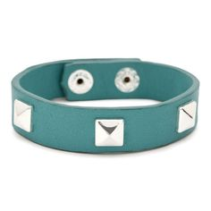 """Pyramid Leather Wrap    $20.00 / Item # B025  Supple turquoise leather band with silver plated pyramid studs and c+i snap closure with double snaps for adjustable fit.    silver plated  nickel-free  7.5"""" approx. length  c+i signature snap button closure  turquoise"""