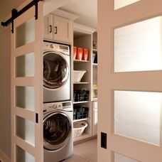 Love the frosted glass inserts in this sliding barn door that separates the laundry room from the rest of the house!