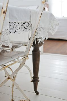 ~ a vintage chair & table leg peeking out from under a delicate cloth~ Lantliv i Norregård