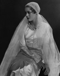 May 1932. Princess Dmitri of Russia (formerly, Countess Marina Golenistcheff-Koutouzoff) is wearing a wedding dress with circlet of orange blossoms at neck and veil, all by Chanel. Image by © Condé Nast Archive/Corbis