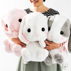 This trio of bunnies from Amuse's Pote Usa Loppy line are amongst the most adorable plushies we have in stock!  These big-size plushies measure a whopping 42 x 30 x 25 cm and are made from a super soft material. The three bunnies are the white blushing Shiroppy, the pink Mimipyon, and the grey and white Panpy. All are remarkably adorable, and so soft you'll never want to let go!   The question...