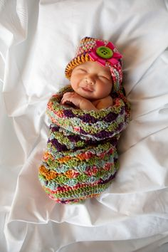 I love this baby cocoon/hat set made for my newest baby girl, Sienna.  This picture makes me smile :)