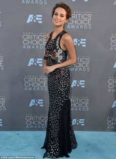 Wow factor: The actress glowed in the fitted frock, which elegantly cinched at the waist before cascading down to the floor