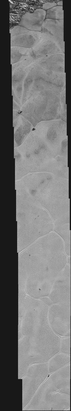 A strip of Pluto stretching into the icy nitrogen plain of Sputnik Planum (the left side of the heart-shaped feature) that's 80 kilometers wide and 700 kilometers long, with a resolution of about 80 meters per pixel