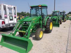 John Deere tractors lined up:2 4066R cab tractors & a 5065E cab